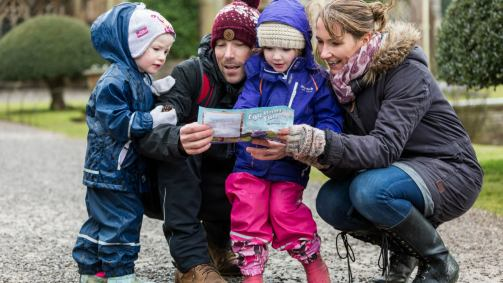 1431771533427-family-with-cadbury-easter-trail-sheet-national-trust-images-cropped